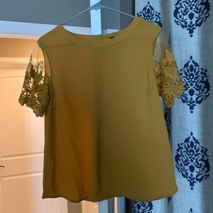 Mustard blouse with lace sleeves